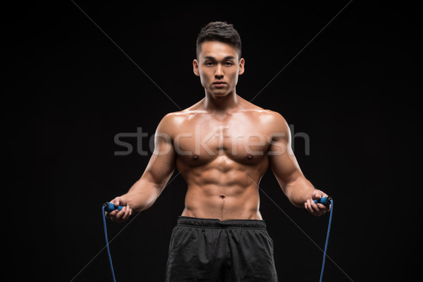 muscular man with skipping rope Stock photo © LightFieldStudios