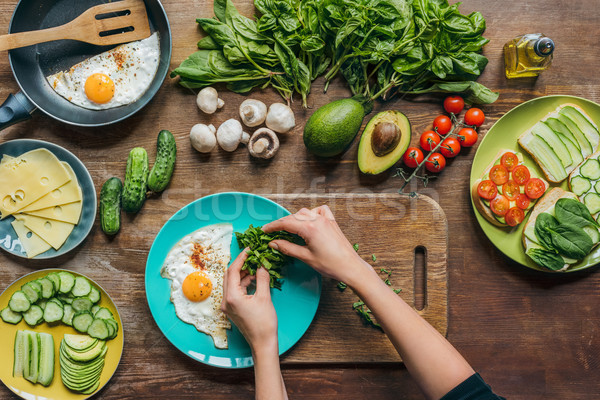 Stok fotoğraf: Kadın · kahvaltı · atış · kadın · eller · kesmek