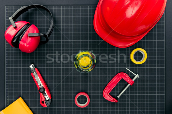Construction equipment on graph paper Stock photo © LightFieldStudios