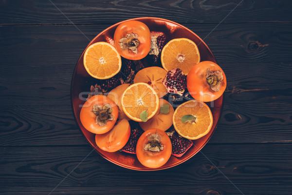 Top мнение Cut апельсинов пластина таблице Сток-фото © LightFieldStudios
