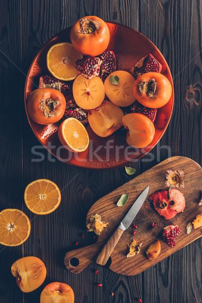 Felső kilátás vág gyümölcsök fa deszka asztal Stock fotó © LightFieldStudios
