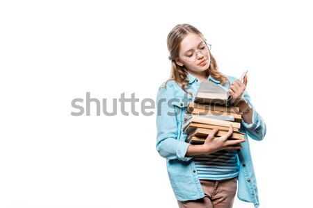 cute teenage girl in eyeglasses reading book isolated on white Stock photo © LightFieldStudios