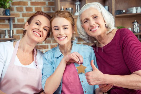Família três gerações família feliz sorridente olhando Foto stock © LightFieldStudios