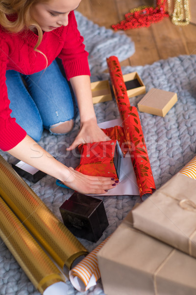 Girl wrapping gift boxes Stock photo © LightFieldStudios