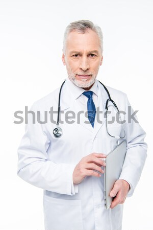 Mature doctor with stethoscope  Stock photo © LightFieldStudios