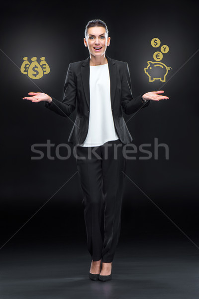 Excited businesswoman with banking concept Stock photo © LightFieldStudios