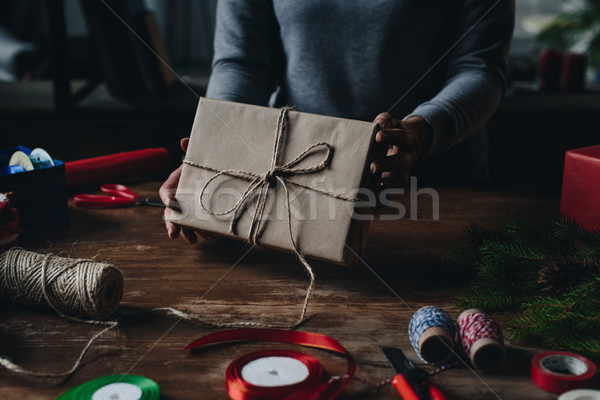 woman showing christmas gift Stock photo © LightFieldStudios