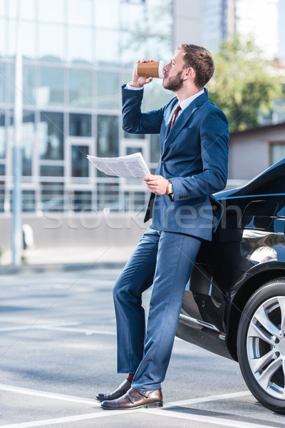 üzletember iszik kávé autó fiatal öltöny Stock fotó © LightFieldStudios