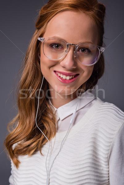 Lány hallgat zene fülhallgató gyönyörű mosolyog Stock fotó © LightFieldStudios