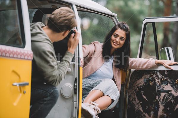 couple taking photo in minivan Stock photo © LightFieldStudios