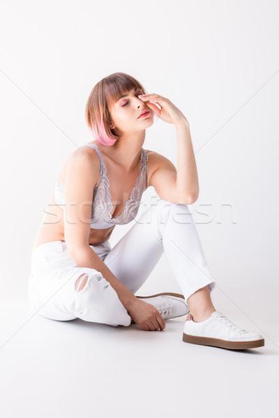 Tired woman sitting on floor Stock photo © LightFieldStudios
