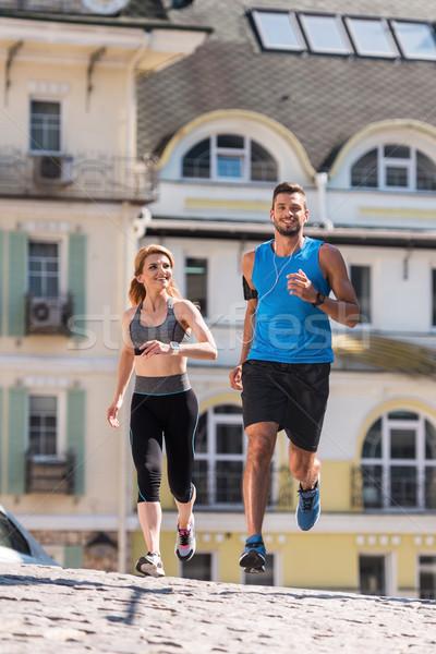 sportswoman and sportsman running in city Stock photo © LightFieldStudios
