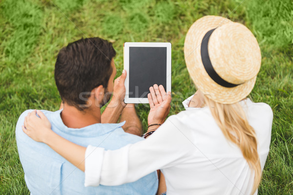 Pár tabletta zöld gyep hátsó nézet együtt Stock fotó © LightFieldStudios