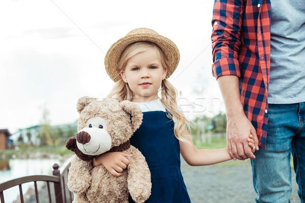 çocuk oyuncak ayı görmek küçük kız el Stok fotoğraf © LightFieldStudios