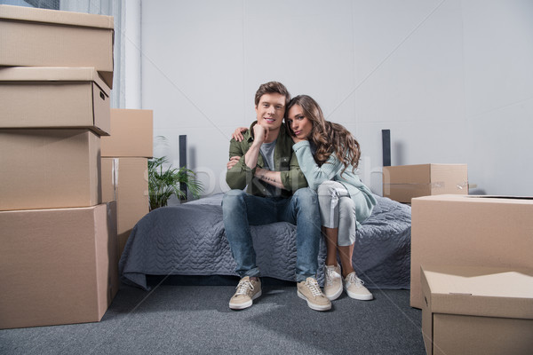 couple sitting on bed at home Stock photo © LightFieldStudios