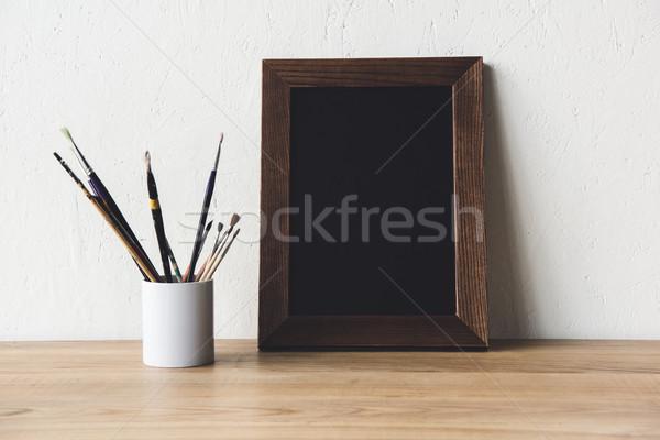 Photo frame pennelli view vuota legno Foto d'archivio © LightFieldStudios