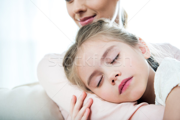 Stock photo: little girl sleeping on mother's arm at home