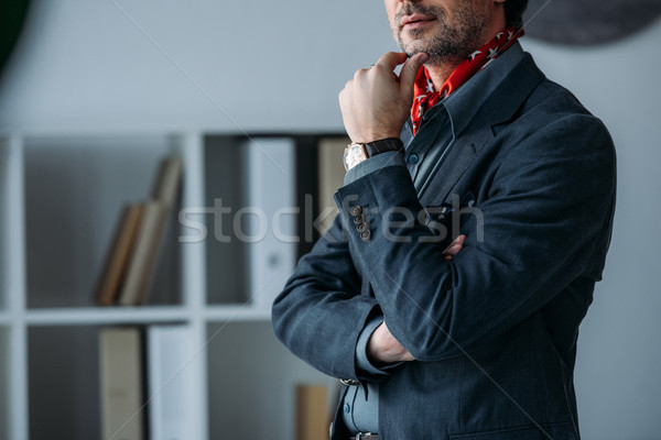 businessman with hand on chin Stock photo © LightFieldStudios