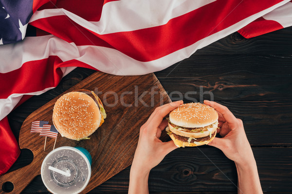 partial view of woman holding burger, presidents day celebration concept Stock photo © LightFieldStudios