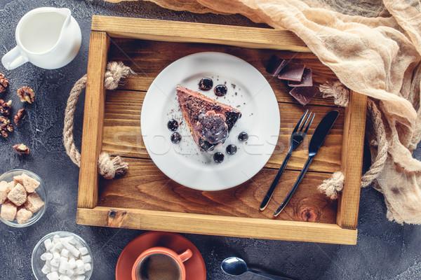 Haut vue appétissant pièce gâteau au chocolat plaque Photo stock © LightFieldStudios