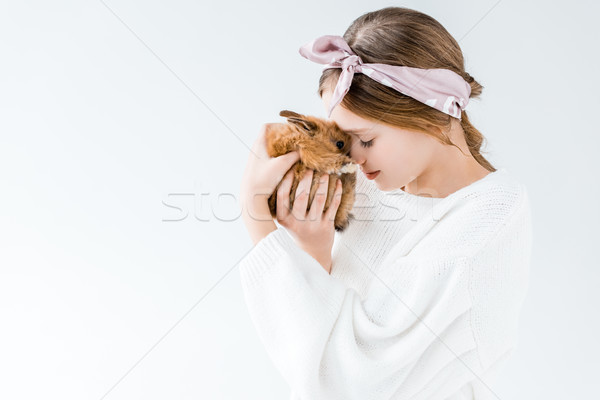 Gyermek tart imádnivaló szőrös nyúl izolált Stock fotó © LightFieldStudios