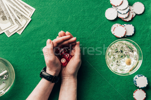 Woman playing dice game by casino table with money and chips Stock photo © LightFieldStudios