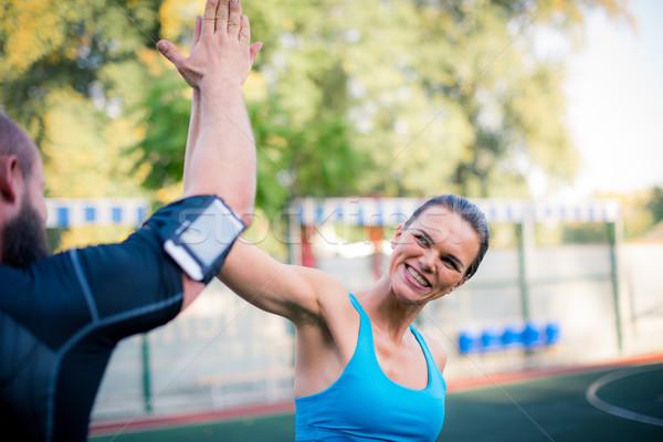 Heureux couple high five entraînement ensemble stade Photo stock © LightFieldStudios