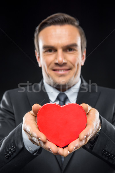 Man hoding toy heart Stock photo © LightFieldStudios