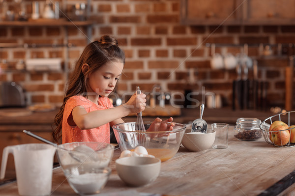 'focused girl mixing ingredients for dough for cake Stock photo © LightFieldStudios