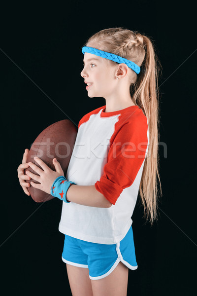 little sportive girl with rugby ball isolated on black, athletics children concept Stock photo © LightFieldStudios