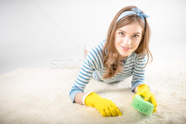 Woman cleaning carpet  Stock photo © LightFieldStudios