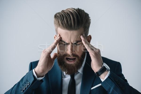 Jungen bärtigen Geschäftsmann Kopfschmerzen grau Stock foto © LightFieldStudios