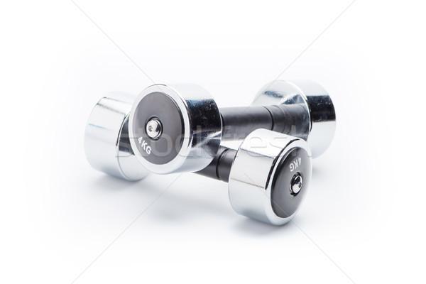 metallic dumbbells isolated on white. equipment sport and healthy living concept Stock photo © LightFieldStudios