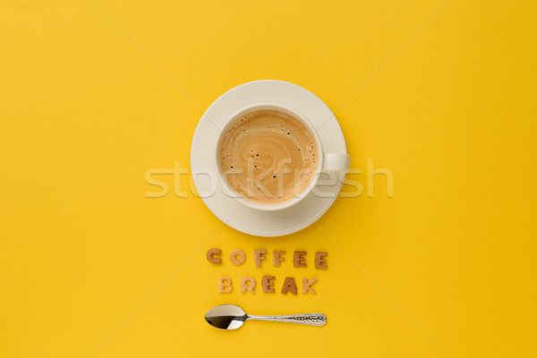top view of cup of espresso coffee, spoon and coffee break lettering Stock photo © LightFieldStudios