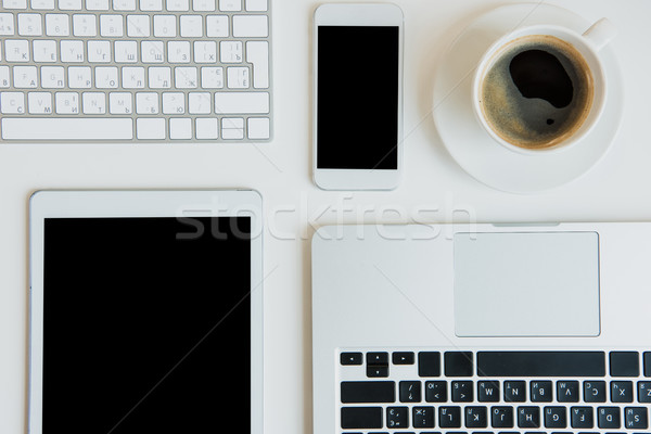 Top view of laptops with digital tablet and smartphone on table top. laptop tablet Stock photo © LightFieldStudios