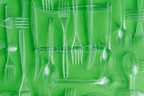top view of set of various plastic cutlery isolated on green Stock photo © LightFieldStudios