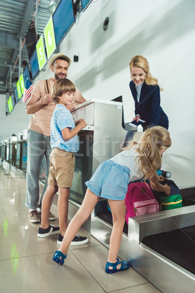 Stock photo: family at check in desk at airport