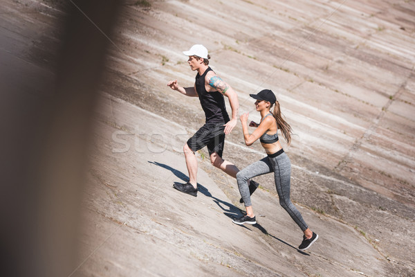 Stock photo: couple jogging on slabs