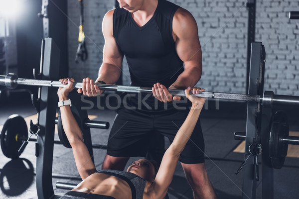 trainer helping woman weightlifting Stock photo © LightFieldStudios