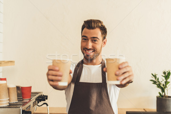 Barista café atención selectiva sonriendo delantal Foto stock © LightFieldStudios