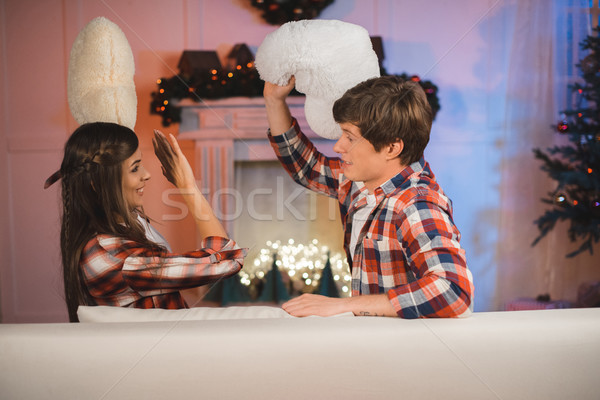 couple having pillow fight Stock photo © LightFieldStudios
