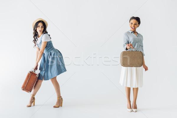 multiethnic women with luggage Stock photo © LightFieldStudios