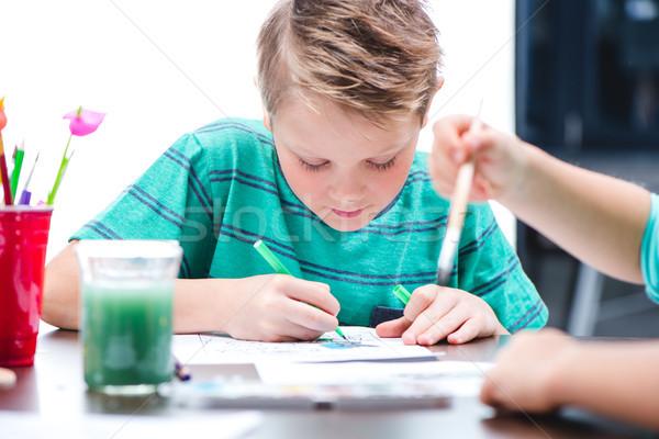 Bambino disegno foto concentrato tavola scuola Foto d'archivio © LightFieldStudios