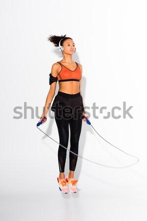 sportswoman with towel and bottle of water Stock photo © LightFieldStudios