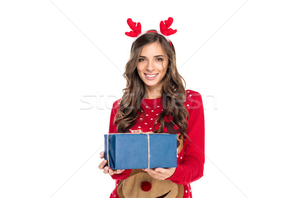 Stock photo: woman holding christmas gift