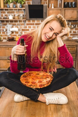 woman serving dinner for boyfriend Stock photo © LightFieldStudios