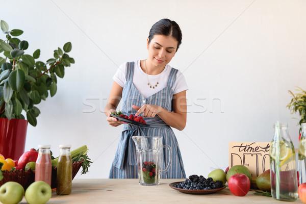 young woman making detox drink Stock photo © LightFieldStudios