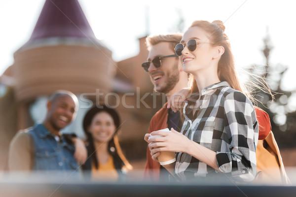 Feliz multicultural amigos atención selectiva calle ropa Foto stock © LightFieldStudios