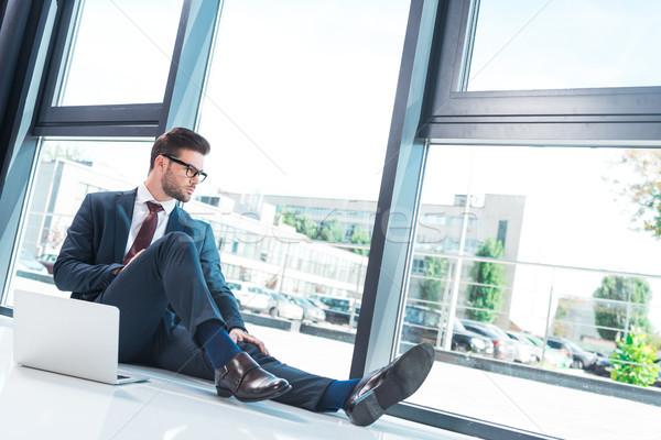 businessman using laptop in office Stock photo © LightFieldStudios