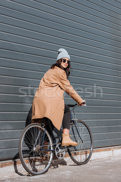 Woman in autumn outfit sitting on bicycle Stock photo © LightFieldStudios